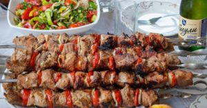 grilled kebabs ready to eat with salad